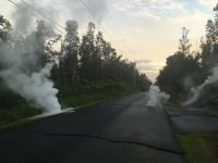 Steaming cracks at 5:57 a.m. HST in Leilani Estates subdivision, moments before a fissure opened up on Kaupili Street. Photo taken Friday, May 4, 2018 courtesy of U.S. Geological Survey
