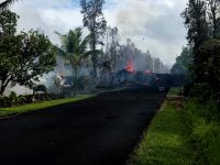 Fissure at Leilani and Kaupili Streets in Leilani Estates subdivision at 8:07 a.m. HST today. Lava on the road was approximately 2 m (about 2 yd) thick. Photo taken Friday, May 4, 2018 courtesy of U.S. Geological Survey