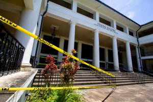 The old Hilo Federal Building, which is home to the Downtown Hilo Post Office, has caution tape in an area where pieces of the building broke off and fell during the series of earthquakes on Friday, May 4, 2018. Photography by Baron Sekiya | Hawaii 24/7