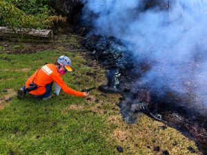 As part of their monitoring work, HVO geologists collect samples of spatter for laboratory analysis; information gained from these samples sheds light on what's happening inside Kīlauea Volcano. This photo, taken at 10:35 a.m. today, shows fissure 10 near the intersection of Malama and Pomaikai Streets in Leilani Estates. Photo taken Sunday, May 6, 2018 courtesy of U.S. Geological Survey
