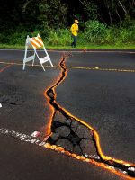 Cracks in Highway 130 at 09:30 a.m. HST. Orange paint was used to outline the cracks. The road remained closed for much of the day. Photo taken Monday, May 7, 2018 courtesy of U.S. Geological Survey