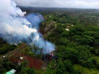At 13:00 p.m. HST. Aerial view from the Hawaii County Fire Department of fissure 15. The fissure cut across Pohoiki Road. Photo taken Wednesday, May 9, 2018 courtesy of U.S. Geological Survey