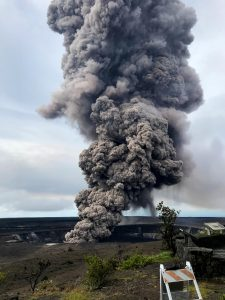 Ash column rises from the Overlook crater at the summit of Kīlauea Volcano. HVO's interpretation is that the explosion was triggered by a rockfall from the steep walls of Overlook crater. The photograph was taken at 8:29 a.m. HST from the Jaggar Museum overlook. The explosion was short-lived. Geologists examining the ash deposits on the rim of Halema'uma'u crater found fresh lava fragments hurled from the lava lake. This explosion was not caused by the interaction of the lava lake with the water table. When the ash cleared from the crater about an hour after the explosion, geologists were able to observe the lava lake surface, which is still above the water table. Photo taken Wednesday, May 9, 2018 courtesy of U.S. Geological Survey