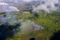 Aerial view of fissure 16 (bottom right) that erupted this morning beginning just before 7 a.m. HST. The fissure is located roughly along the alignment of the earlier fissures (steam in top left photo) and 1.3 km (0.8 miles) northeast of fissure 15 and Pohoiki Road. Photograph taken Saturday, May 12, 2018 courtesy of Hawai'i County Fire Department.