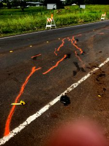 At 10:31 a.m. HST. Cracks on Hwy 132 marked with orange spray paint to track changes through time. Photo taken Sunday, May 13, 2018 courtesy of U.S. Geological Survey