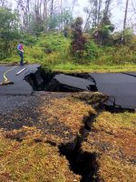 HVO geologist next to cracks on Nohea Street in Leilani Estates this morning. These cracks expanded significantly in the past day. Note the vertical offset across the cracks. Photo taken Thursday, May 17, 2018 courtesy of U.S. Geological Survey