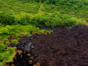 """The Fissure 17 flow front has slowed substantially with only small amounts of pasty """"toothpaste"""" lava oozing out from the flow front. However lava continues to be erupted from the active fissure. This lava appears to be accumulating within the flow and has widened the flow margins slightly. Photo taken Thursday, May 17, 2018 courtesy of U.S. Geological Survey"""