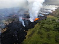 Aerial view of erupting fissure 22 and lava channels flowing southward from the fissure during an early morning overflight. View is toward the southwest. Photo courtesy of Volcano Helicopters.