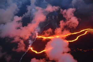 On May 23, 2018, the Hilo Civil Air Patrol captured this evening photograph of the coastline where lava flows are entering the sea. There are currently three primary ocean entry points, which have evolved over the course of the eruption. Photo courtesy of J. Ozbolt, Hilo Civil Air Patrol.