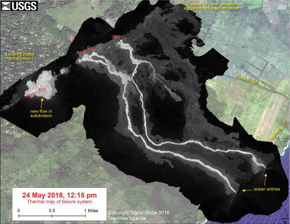 This thermal map shows the fissure system and lava flows as of 12:15 pm on Thursday, May 24. Two channelized lava flows are reaching the ocean. In addition, a new lava flow is active in Leilani Estates subdivision, near Fissure 7. The black and white area is the extent of the thermal map. Temperature in the thermal image is displayed as gray-scale values, with the brightest pixels indicating the hottest areas. The thermal map was constructed by stitching many overlapping oblique thermal images collected by a handheld thermal camera during a helicopter overflight of the flow field. The base is a copyrighted color satellite image (used with permission) provided by Digital Globe.