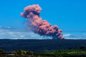 A 5.0 magnitude earthquake around 10:31 a.m. Thursday, May 3, 2018 triggering a small collapse at Pu'u Ō'ō vent that sent a rose-colored plume billowing skyward. The plume was visible throughout Hawaii Volcanoes National Park and neighboring communities, including Kalapana Gardens, where this photo was taken. NPS photo by Janice Wei
