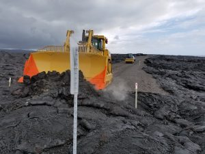 Bulldozer pushing lava aside to open up Chain of Craters-Kalapana Road. NPS Photo