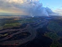 This view, looking south at Kīlauea's lower East Rift Zone, was captured during HVO's 6:00 a.m. HST helicopter overflight today. It shows continued fountaining of fissure 8 and the lava flow channel fed by it. Lava continues to flow quickly in these braided channels; the flow margins are currently stable and have not experienced any breakouts since June 5. Photo taken Wednesday, June 6, 2018 courtesy of U.S. Geological Survey