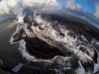 This fish-eye view of the lava delta filling the former Kapoho Bay shows that while the delta margin nearest the ocean has cooled somewhat, the lava flow front is still very hot and producing laze (lava haze). Laze is a local hazard composed of acidic gases and volcanic glass fragments and should be avoided. Photo taken Wednesday, June 6, 2018 courtesy of U.S. Geological Survey