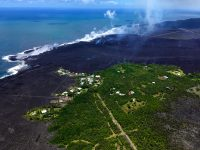 Views from HVO's helicopter overflight at 1PM HST, show the remains of the Kapoho Beach Lots subdivision and the fissure 8 flow front. The northern flow margin in this area was unchanged from HVO's morning flight and appeared to have stopped advancing at the time of the flight. Photo taken Wednesday, June 6, 2018 courtesy of U.S. Geological Survey