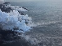 """The Kapoho ocean entry (as of 6:30 a.m. HST), where the interaction of fissure 8 lava and seawater produces a white plume called """"laze."""" Laze is a mixture of condensed acidic steam, hydrochloric acid gas, and tiny shards of volcanic glass, and can be irritating to the lungs, eyes, and skin. Photo taken Friday, June 8, 2018 courtesy of U.S. Geological Survey"""