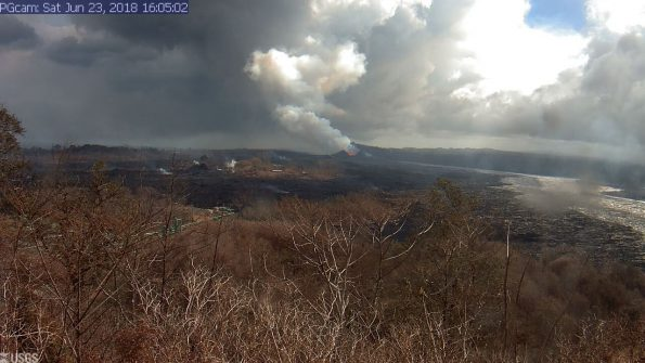 This image is from a temporary research camera positioned near Kapoho looking southwest. From left to right, one can see the eruptive fissures, with Fissure 15 on the far left, and Fissure 8 near the center. Webcam image taken Saturday, June 23, 2018 courtesy of U.S. Geological Survey