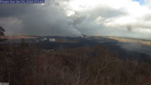 This image is from a temporary research camera positioned near Kapoho looking southwest. From left to right, one can see the eruptive fissures, with Fissure 15 on the far left, and Fissure 8 near the center. Webcam image taken Sunday, June 24, 2018 courtesy of U.S. Geological Survey