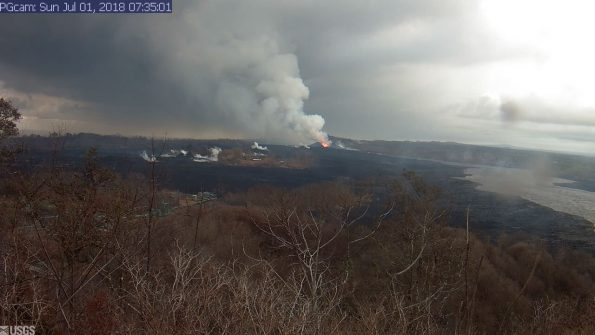 This image is from a temporary research camera positioned near Kapoho looking southwest. From left to right, one can see the eruptive fissures, with Fissure 15 on the far left, and Fissure 8 near the center.Webcam image taken Sunday, July 1, 2018 courtesy of U.S. Geological Survey