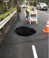 A sinkhole opened on Mamalahoa Highway (Route 11) near the Volcano golf course. Photo courtesy of NPS