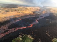 """Braided section of the lava channel located """"downstream"""" between about 3.5 to 6 km (2.2 to 3.7 mi) from fissure 8 (upper right). The width of the two channels in the middle center is about 325 m (1,065 ft). View is toward the southwest. Photo taken Sunday, July 8, 2018 courtesy of U.S. Geological Survey"""