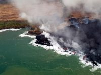 During this morning's overflight, USGS scientists noted that the distal fissure 8 flow margin had not advanced overnight, and remained less than 175 m (0.1 mi) from the Pohoiki boat ramp in Isaac Hale Park. But they also observed that lava along the western edge of the flow was fuming, so it could start oozing from that edge. Photo taken Monday, July 30, 2018 courtesy of U.S. Geological Survey