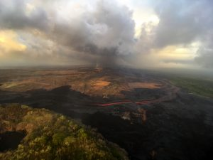 In this aerial view, taken during HVO's overflight this morning, you can follow the lava channel from fissure 8 (gas plume visible in far distance) as it wends its way toward Kapoho Crater (lower left), where it then heads south toward the ocean. Photo taken Tuesday, July 31, 2018 courtesy of U.S. Geological Survey