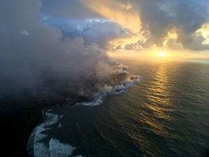The fissure 8 ocean entry and laze plume as they appeared at sunrise this morning. The Pohoiki boat ramp is visible just below the plume (slightly left of center). Photo taken Tuesday, July 31, 2018 courtesy of U.S. Geological Survey