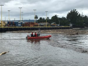 A Coast Guard small boat crew from the Coast Guard Cutter Oliver Berry (WPC 1124) beings a port assessment of the port of Hilo, Hawaii, Aug. 24, 2018. The Coast Guard is working proactively with the State of Hawaii and the maritime industry to reopen ports as soon as is safe to do so. (U.S. Coast Guard photo by Petty Officer 2nd Class Sydney Niemi/Released)