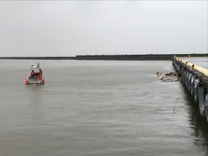 A small boat crew from Coast Guard Cutter Oliver Berry (WPC 1124) begins an assessment of the port of Hilo, Hawaii, Aug. 24, 2018. The Coast Guard is working proactively with the State of Hawaii and maritime industry to reopen ports as soon as is safe to do so after the passing of Hurricane Lane. (U.S. Coast Guard photo by Petty Officer 2nd Class Sydney Niemi/Released)