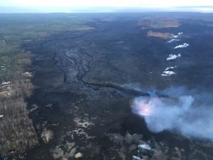 This morning's overflight revealed a weak to moderately active pond of lava bubbling within the fissure 8 cone, but no visible supply of lava from fissure 8 into the channel. The perched channel and braided sections downstream were essentially crusted over with some incandescence noted. Active flow in the channel was observed immeidately west Kapoho Crater. Photo taken Monday, August 6, 2018 courtesy of U.S. Geological Survey