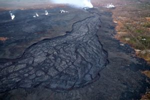 Lava in the fissure 8 channel is now crusted over. Fissure 8 and other inactive fissures are steaming the background, a common sight during early morning overflights (cooler air temperature results in more condensation, making steam more visible). Photo taken Tuesday, August 7, 2018 courtesy of U.S. Geological Survey