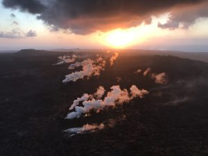 "During their overflight this morning, HVO scientists observed no new activity at any of the lower East Rift Zone fissures. At the fissure 8 vent, a ""puddle"" of sluggish lava remained in the cone. No other incandescent lava was seen along the fissure 8 channel, except at the ocean entry. Some other fissures were steaming, as seen here. Photo taken Monday, August 13, 2018 courtesy of U.S. Geological Survey"