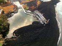 A small lagoon has been created at the Pohoiki boat ramp due to long-shore transportation of black sand that is accumulating from the jetty to the shoreline. Photo taken Wednesday, August 15, 2018 courtesy of U.S. Geological Survey