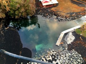 The bottom of the newly-formed lagoon at the Pohoiki boat ramp is visible in this aerial view, looking nearly straight down. Photo taken Wednesday, August 15, 2018 courtesy of U.S. Geological Survey