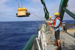 University students assisted with deployment of ocean-bottom seismometers off the south coast of Kīlauea Volcano from the deck of the R/V Ka`imikai-o-Kanaloa, a 223-foot research vessel operated by the University of Hawai'i, on July 10, 2018. Photograph courtesy of Jackie Caplan-Auerbach, Western Washington University.