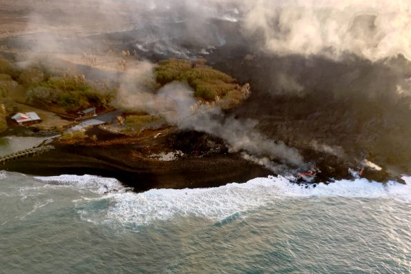 On August 9, 2018, visibly active lava on Kīlauea Volcano's lower East Rift Zone was limited to a small pond deep with the fissure 8 cone and small streams of lava oozing into the ocean near Isaac Hale Beach Park (shown here) and at Kapoho Bay. USGS scientists are closely monitoring the volcano, watching for any signs that might indicate if Kīlauea's rift zone eruption and summit subsidence are pau or paused. USGS photo by I. Johanson.