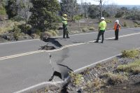 Large sink hole and crack on Crater Rim Drive Keanakakoi. NPS Photo