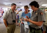 Staff at the Kilauea Visitors Center answer questions on the reopening day of Hawaii Volcanoes National Park. Photography by Baron Sekiya | Hawaii 24/7