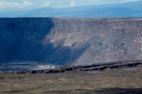 The collapsed crater of Kilauea Caldera with large cracks along the edge of the collapsed area from the explosive earthquake events at Hawaii Volcanoes National Park. Photography by Baron Sekiya | Hawaii 24/7