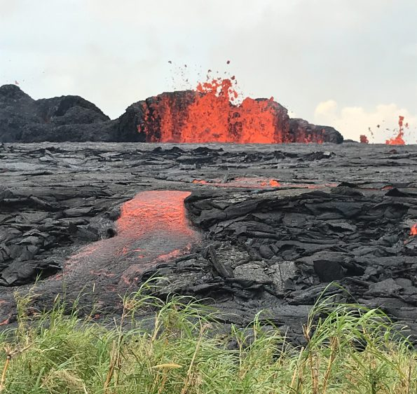 When Kīlauea Volcano's lower East Rift Zone first erupted on May 3, 2018, lava temperatures were about 2000 degrees Fahrenheit. As the eruption progressed, with fresher magma feeding the fissures, the erupted lava became progressively hotter, resulting in more fluid and far-reaching lava flows (May 21 shown here). Lava temperatures have now leveled out at 2070–2085 degrees Fahrenheit. These temperature measurements provide insight on what's happening inside the volcano.  USGS photo by C. Parcheta.