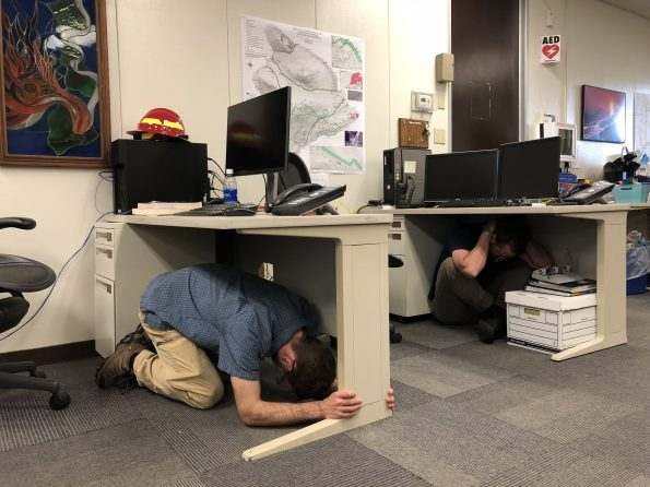 """On October 18 at 10:18 a.m. HST, scientists at the Hawaiian Volcano Observatory practiced """"Drop, Cover, Hold on!""""—the best actions to take during an earthquake to prevent injuries—during the Great Hawaii ShakeOut. Since 1868, more than 30 magnitude-6.0 or greater earthquakes have rattled the Hawaiian Islands—most recently on May 4, 2018 (M6.9)—so it's important for Hawaii residents to know (and practice) what to do when the ground shakes. The Great Hawaii ShakeOut is an annual earthquake awareness and preparedness event held on the third Thursday of October. For more info on earthquake safety, please visit https://www.shakeout.org/hawaii/."""