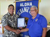 Officer Wyatt Kaili-Leong with Aloha Exchange Club Member James Sanborn. Kaili-Leong is Officer of the Month for September 2018.