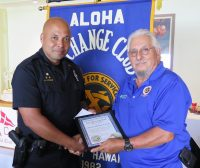 Officer Melvin Vargas with Aloha Exchange Club Member John Stewart. Vargas is Officer of the Month for July 2018.