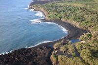 A large black sand beach remains in front of the Pohoiki boat ramp. Roadway construction over the recent lava flows can be seen at the top of the image. Photo taken Wednesday, November 7, 2018 courtesy of U.S. Geological Survey