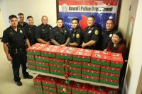 Hawaii Police Department Officers gather shoe-box gifts for Operation Christmas Child