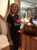 Momi Greene with a decorated Ipu (gourd).