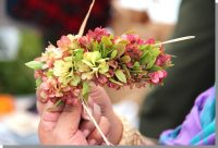 Making a lei in the wili style. NPS Photo