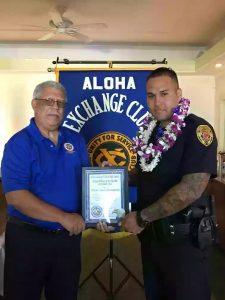 Aloha Exchange Club Member James Sanborn with Officer Joshua Baumgarner.