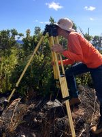 An HVO scientist levels a tripod over a benchmark during a routine campaign GPS survey on Kīlauea's lower East Rift Zone. USGS photo by L. DeSmither. Photo taken Tuesday, February 19, 2019 courtesy of U.S. Geological Survey